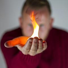 Man holding fire