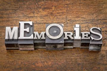 memories word in metal type