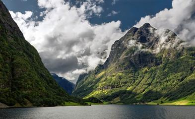 Norway, Aurland, Sogn og Fjordane, Odden, Cloudy sky above river and mountain range