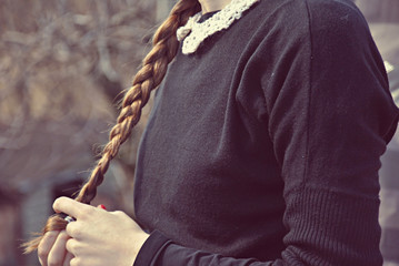 Girl playing with her braid