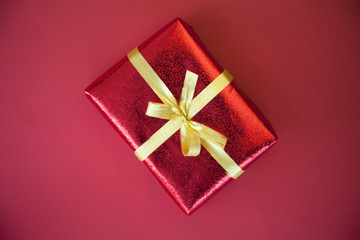 Gift wrapped present with gold bow