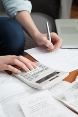 Young woman working on home finances