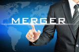 Businessman hand pointing to MERGER sign on virtual screen poster