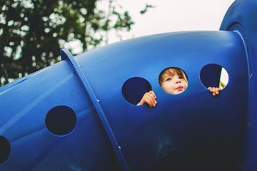 Boy (2-3) in playground