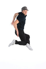 young dancer jumping on white background in studio.