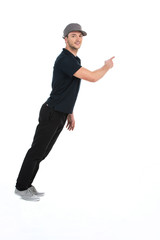 young dancer pointing away on white background in studio.