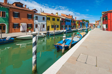 Italy, Venice Province, Burano, Colorful houses by canal