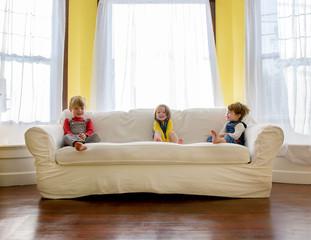 Children ( 2-3, 4-5 ) sitting on sofa