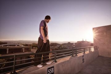 USA, Colorado, Young man doing Parkour on urban wall