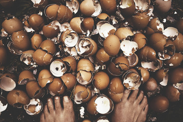 Self-photograph of woman standing on eggshells