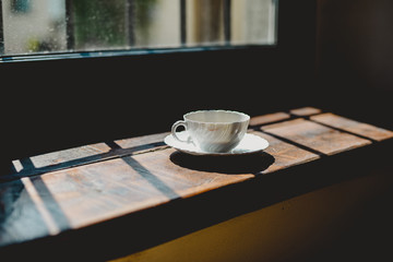 Italia, Lombardia, Pavia, Cup of coffee beside window