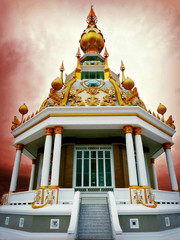 Thailand, Khon Kaen, Toong Setthi Temple with dramatic sky in background