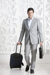 Businessman traveling with briefcase and travel bag