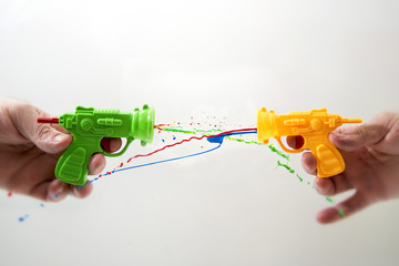 Toy guns shooting colorful paint