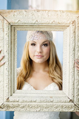 Bride holding picture frame