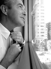 USA, California, San Francisco, Profile of man tying tie