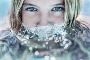 Girl with face partially submerged in water