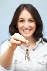 Young Woman Holding Out Keys