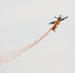 Low angle view of performing stunt plane