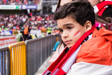 Spain, Madrid, Boy (6-7) at football match