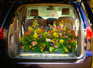 Flowers in car trunk