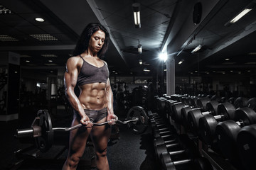 sexy fitness woman with perfect fitness body in gym