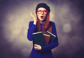 girl in blue dress with books