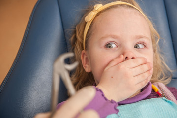 portrait of scared girl at dentist's office.