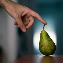 Spain, Man touching pear
