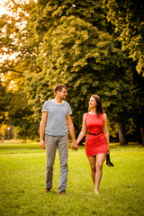 Young couple walking on grass