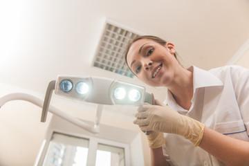 Happy female dentist doctor smiling in camera.