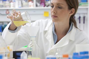 Pharmacist pouring liquid