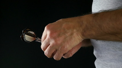 Close up of a player preparing and throwing a dart
