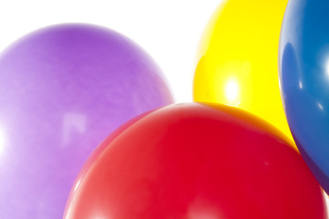 Close up of four helium filled balloons