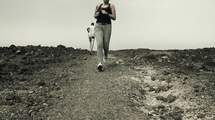 Young people jogging on desert, slow motion shot at 240fps