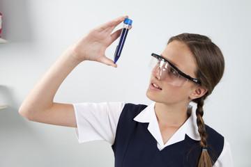 Teenage Girl Examining Test Tube