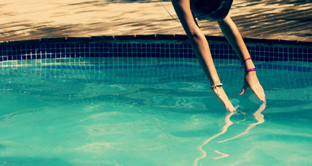Spain, Barcelona, Girl jumping into pool in summer