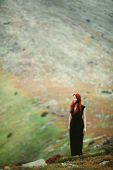 Young woman in mountains