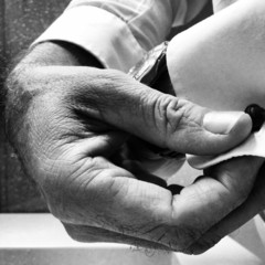 Man putting on cufflinks