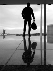 Spain, Barcelona, Man standing at airport