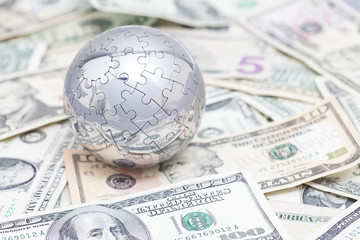 Globe puzzle on US dollars