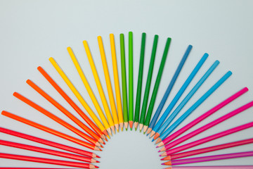 Colored Pencils arranged in semi circle
