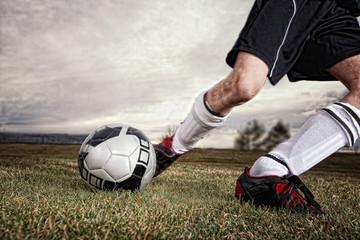 USA, Colorado, Boy kicking soccer ball