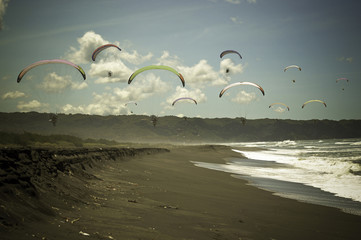 Indonesia, Yogyakarta Region, Jogja, Paragliding above Parang Tritis Beach