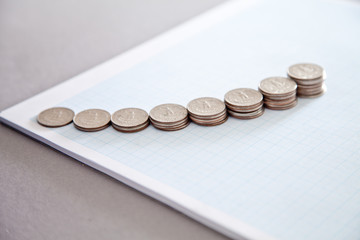 Multiple stacks of US coins on graph paper