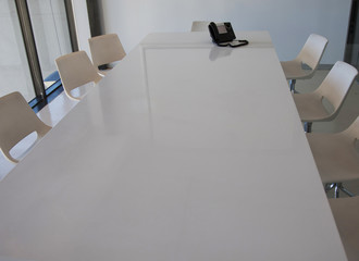 Contemporary office conference table and chairs with phone