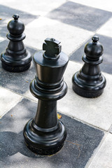 Big plastic chess game on checkerboard