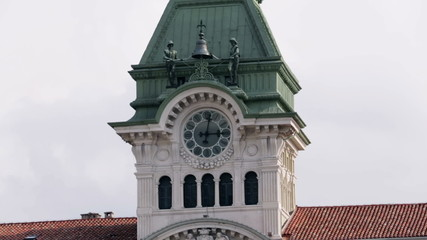 Bell tower with huge clock on external wall