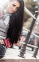 Portrait of attractive woman with long black hair