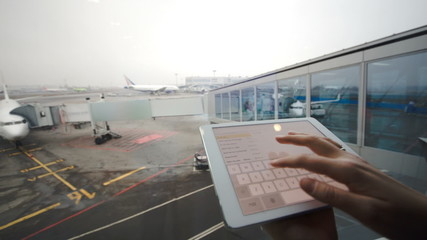 Woman with tablet computer at airport